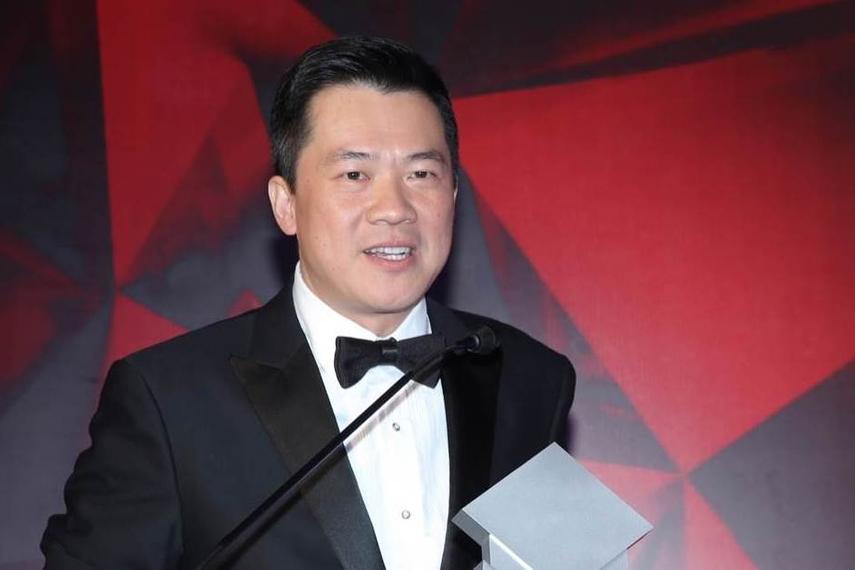 Tuan Lam accepting the award