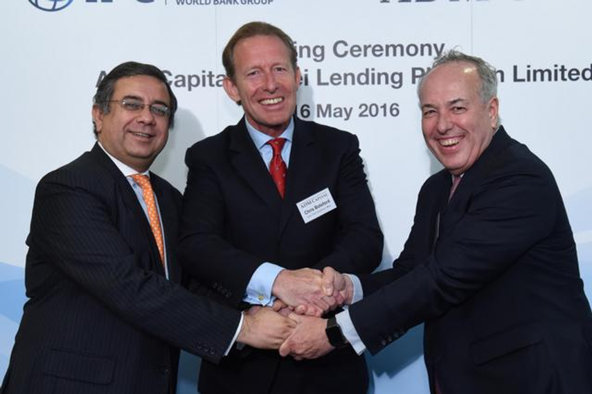 The launch ceremony: (from left) Vivek Pathak of IFC, Christopher Botsford of ADM Capital and Marcos Brujis of IFC