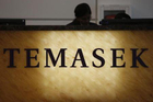 Temasek defends China holdings amid big losses