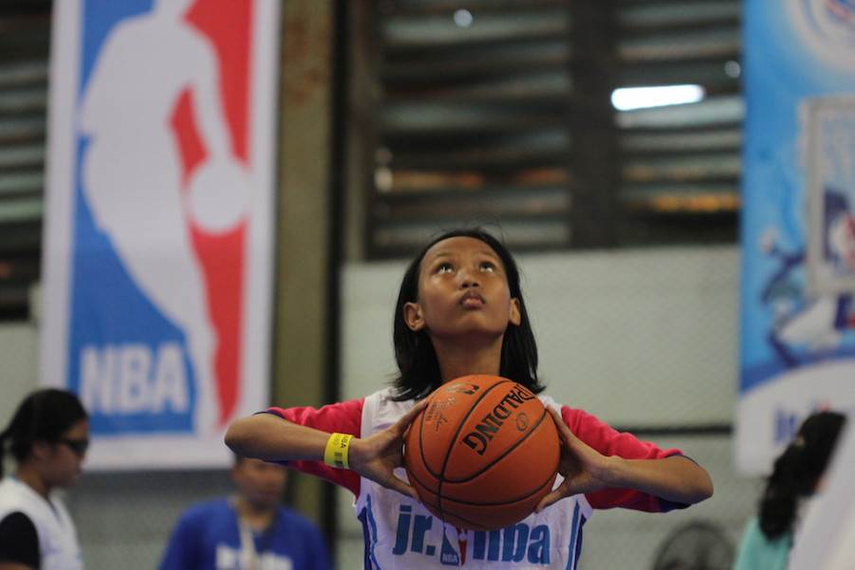 A hopeful participant takes aim at a recent Junior NBA camp in Indonesia.