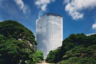 Dentsu revenue up but profits down, plans structural change