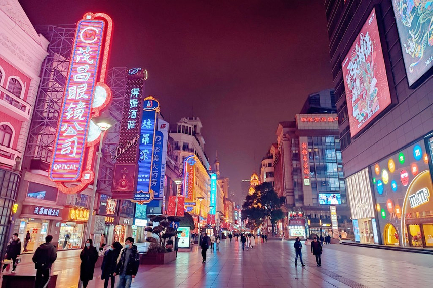 As China has been successful in containing the spread of Covid-19, the public is beginning to resume outdoor activities. Here, people walk through Nanjing road in Shanghai on January 21, 2021.