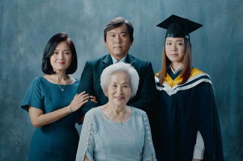 AXA presents a grim 'Family portrait'