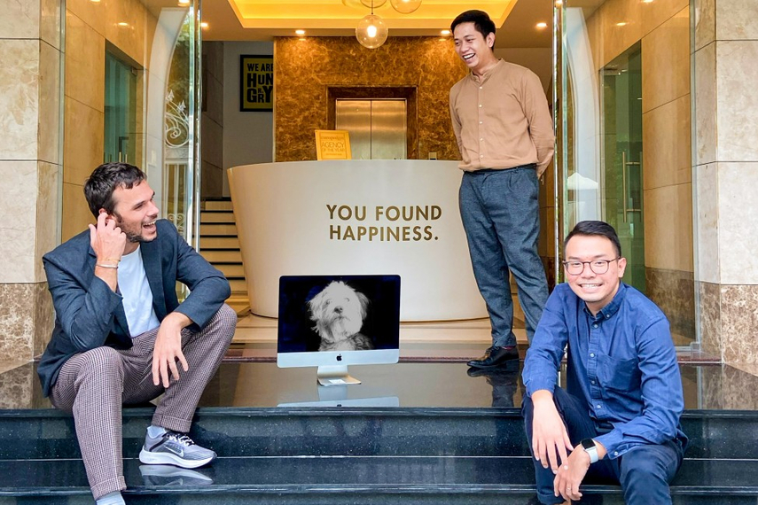 Happiness Saigon's core management team from left to right: Alan Cerutti, Greg Titeca (represented by the dog), Son Nguyen, Nhat Qui.