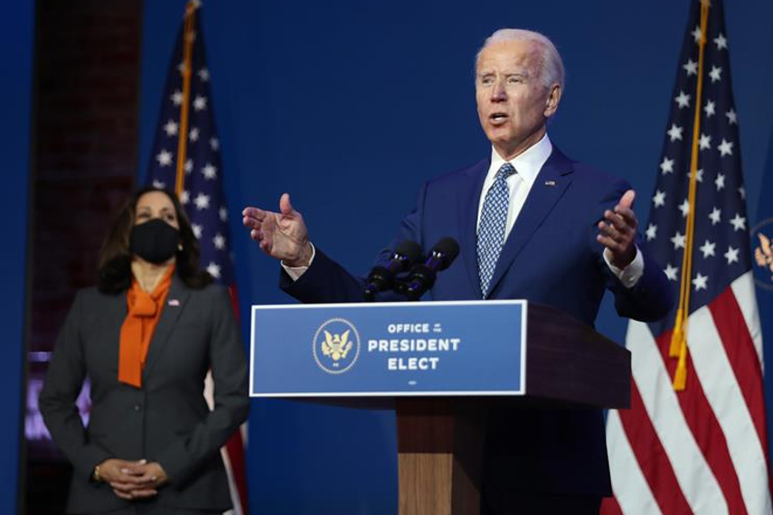 Biden: flanked by vice-president-elect Kamala Harris (Getty Images)