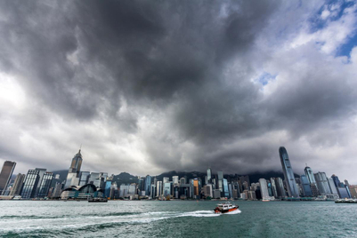 Hong Kong weathers a perfect storm