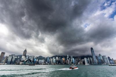 Hong Kong weathers a perfect storm