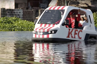 Poor residents of a flooded Philippines village need...KFC?