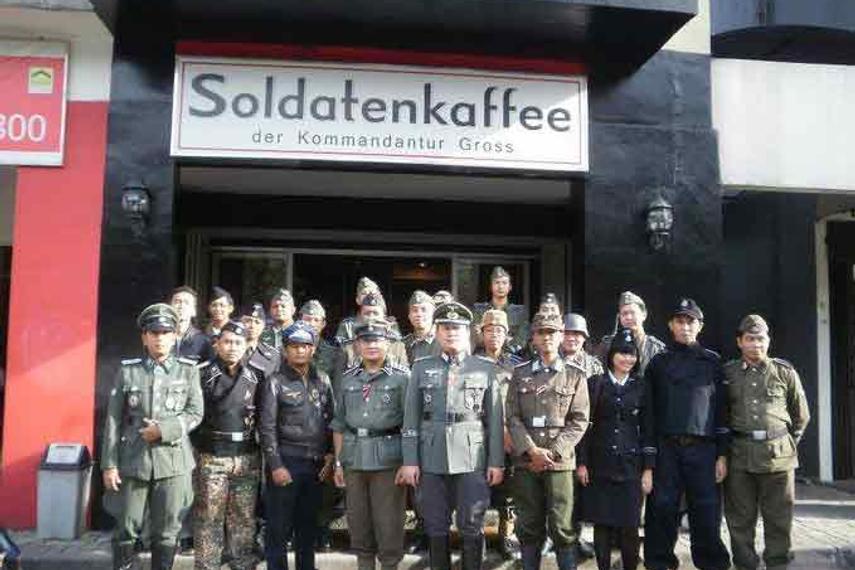 Soldantenkaffee's staff posing in their Hitler-themed costumes