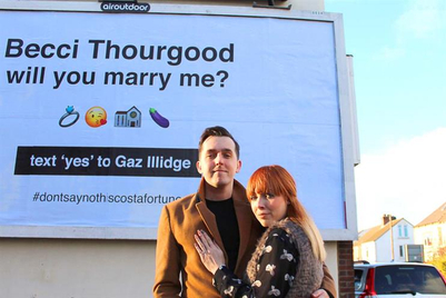 Tuesday Morning Gloom Buster: Man rents billboard to propose to girlfriend