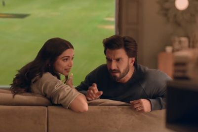 Cricket commentary from Deepika Padukone as Ranveer Singh looks away from the game