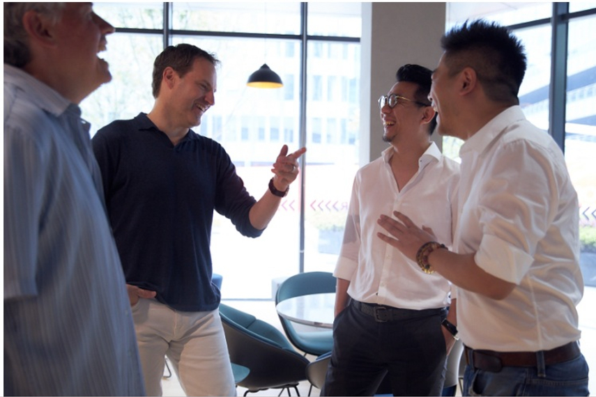 Jon Cook is in a good mood these days, seen here having some laughs with staff in Shanghai