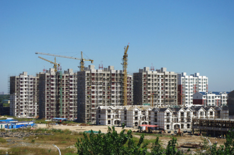 Chinese developers' bonds boosted by rate cut