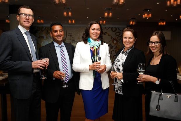 Reuben Rattos and Julie Cameron-Doe of Aristocrat Leisure with UBS bankers