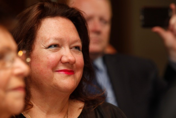 Chairman of Hancock Prospecting Group, Gina Rinehart, listens to the opening address