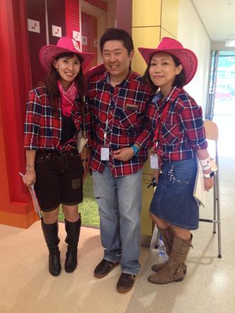 PwC's marketing team dressed as cowboys & cowgirls.