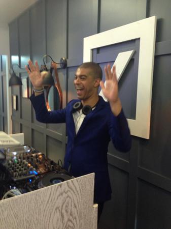 DJ Miles Slater kept the vibe fun in Deutsche's box.