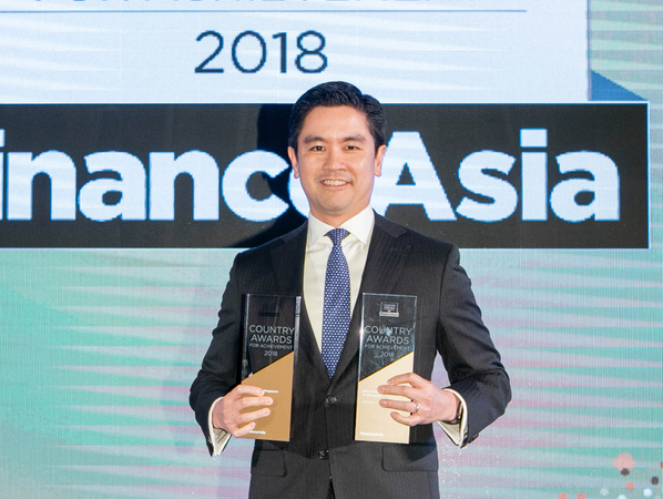 Anuruk Karoonyavanich from DBS Bank collects the Best Bank and Best Investment Bank awards for Singapore