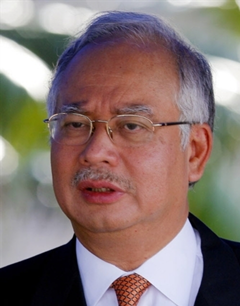 Malaysia's prime minister reaches out to investors