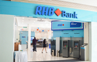 Abu Dhabi fund sells part of RHB stake at a big loss
