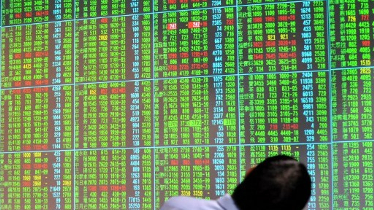 Taiwan's securities industry is suffering due to new securities taxes, which led to trading volume dropping 53%, and the stock market losing 14.3%.