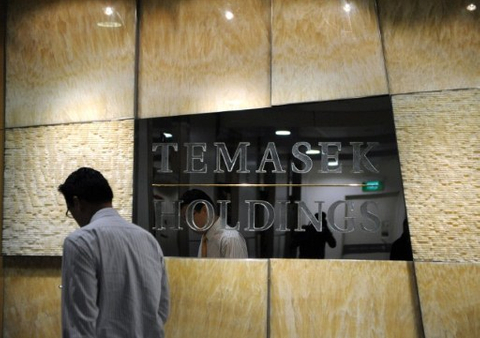 Temasek trims SingTel stake and GE Capital sells shares in Thai bank