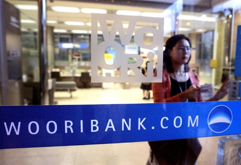 Banks line up for Woori sales