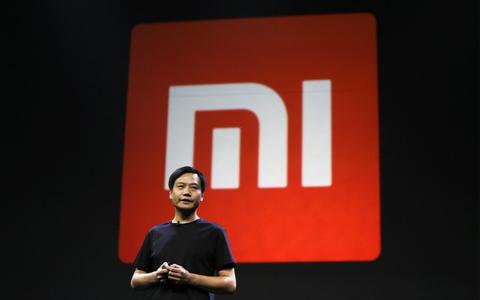 Xiaomi seals jumbo IPO amid stormy markets