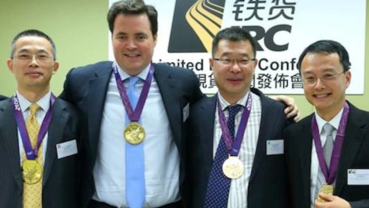 "<div style=""text-align: left;""> Liu Qing Chun of Minmetals Cheeryglory, Jay Hambro of IRC, Cai Suixin of General Nice and Raymond Woo of IRC celebrate the deal with Olympic medals </div>"