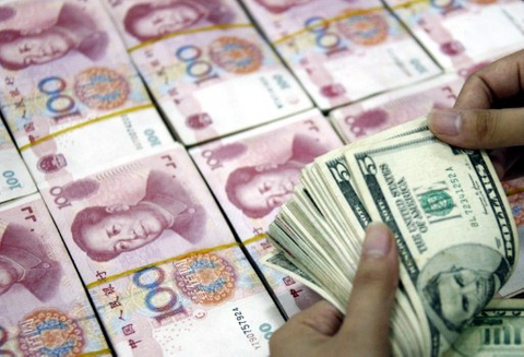 China blames markets for weak renminbi
