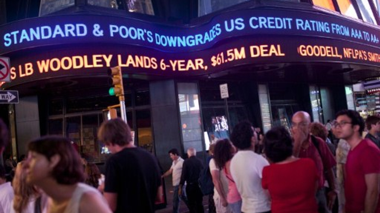 "<div style=""text-align: left;""> A news ticker in Times Square announces the downgrade (AFP) </div>"